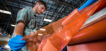 photo of young man working with composites materials