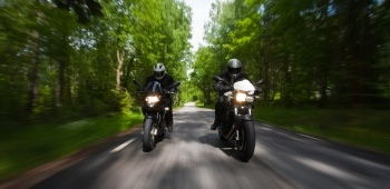 Photo of motorcycle rider on the road